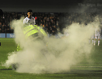 Football - 2019 / 2020 Emirates FA Cup - First Round, Replay: Bromley vs. Bristol Rovers<br /> <br /> A firework is thrown onto the pitch from the Bromley fans, at Hayes Lane.<br /> <br /> COLORSPORT/ANDREW COWIE