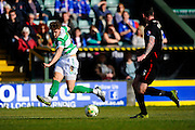 Yeovil Town's Ryan Bird crosses a ball into the box during the Sky Bet League 2 match between Yeovil Town and Carlisle United at Huish Park, Yeovil, England on 25 March 2016. Photo by Graham Hunt.