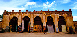 A carpet sellers shop beside the part ruined and abandoned Kasbah at Telouet, southern Morocco<br /> <br /> (c) Andrew Wilson | Edinburgh Elite media