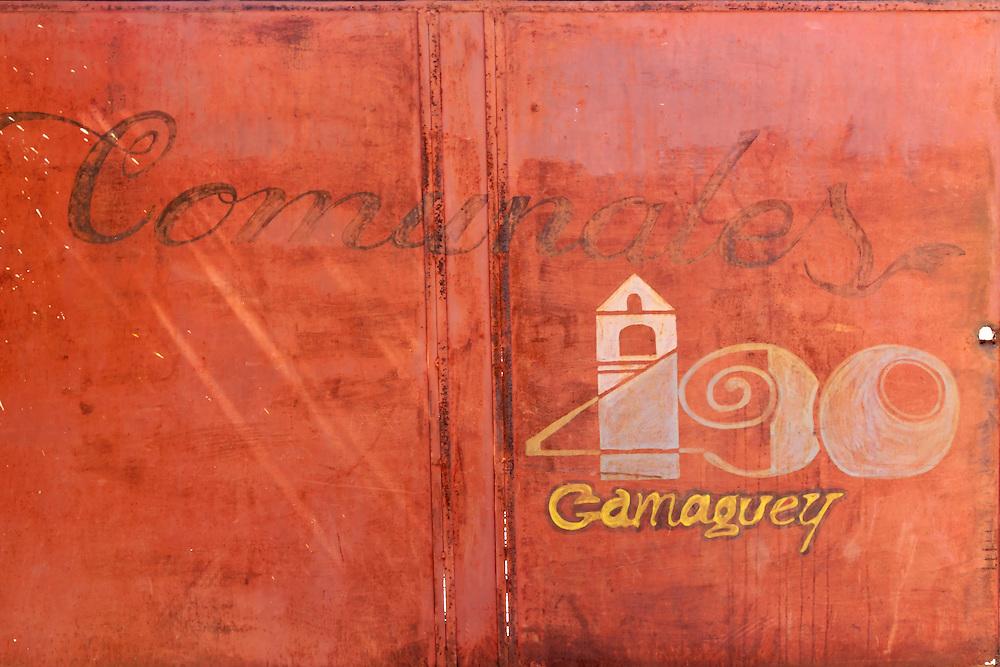Faded sign in Camaguey city, Camaguey, Cuba.