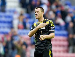 WIGAN, ENGLAND - Sunday, August 19, 2012: Chelsea's captain John Terry celebrates his side's 1-0 win away to Wigan Athletic after the Premiership match at the DW Stadium. (Pic by Vegard Grott/Propaganda)