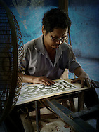 Craftsman in a workshop of Hue, Vietnam, Southeast Asia