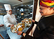 India, Rajasthan. Maharajas' Express luxury train. The kitchen galley.