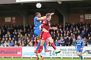 Darius Charles defender for AFC Wimbledon (32) and Crawley Town Defender Sonny Bradley (6) jump during the Sky Bet League 2 match between AFC Wimbledon and Crawley Town at the Cherry Red Records Stadium, Kingston, England on 16 April 2016. Photo by Stuart Butcher.