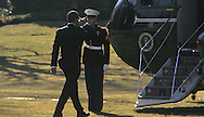 President Barack Obama salute the Marine as he boards  Marine One on the South Lawn as he departs for Denver, CO on February 17, 2009.  Photograph by Dennis Brack