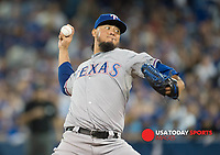 Oct 8, 2015; Toronto, Ontario, CAN; Texas Rangers opening pitcher Yovani Gallardo (49) pitches against Toronto Blue Jays in the second inning of game one of the ALDS at Rogers Centre. Mandatory Credit: Peter Llewellyn-USA TODAY Sports