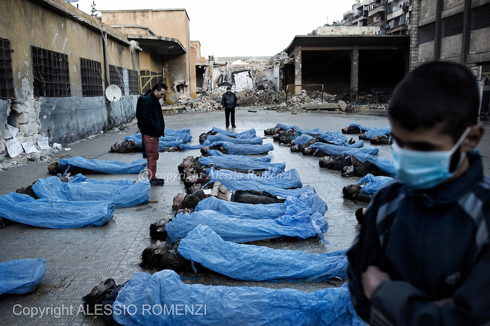 SYRIA, ALEPPO: Syrians from the liberated side of Aleppo are seen as they try to identify the bodies of more than 60 people found dead inside the river Oweq. Nearly all of them have been found shot in the head,  with bounded hands and ankles. January 29, 2012. ALESSIO ROMENZI