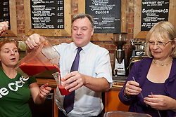 Shadow Chancellor Ed Balls visits  the Core Juice Bar Swindon, United Kingdom, and makes a smoothie with the aid of Erica Fowers the bar manager , Anne Snelgrove the Labour Candidate  for Swindon South <br /> .Thursday, 28th November 2013. Picture by i-Images