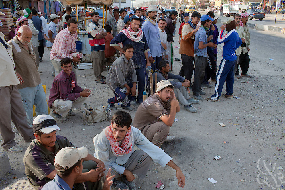 Unemployed Iraqi men wait on a southwest Baghdad street for possible work as day laborers August 25, 2010. The unemployment rate in Iraq is pegged officially at around 20%, although the real number is considered to be much higher.   .