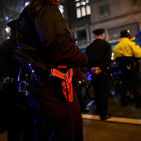 "Lights illuminate a police officer's handgun as he monitors activity during a ""Queer Rage"" dance party outside the location of the 2017 ""Congress of Tomorrow"" Joint Republican Issues Conference in Philadelphia, Pennsylvania, U.S. January 25, 2017."