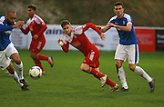 Whitehawk striker Jake Robinson sprints for the ball during the FA Trophy match between Whitehawk FC and Dover Athletic at the Enclosed Ground, Whitehawk, United Kingdom on 12 December 2015. Photo by Bennett Dean.