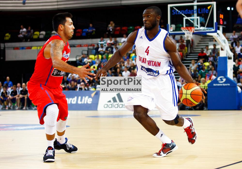 GB men vs Puerto Rico basketball at the Copper Box Arena. Ogo Adegboye (04) on offence. 11/08/2013 (c) MATT BRISTOW