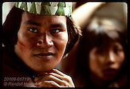 Young Kanamari man wears native jewelry, paint and headband in tribal village of Tres Unidos, Amazonas, Brazil.