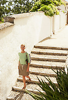 Tourist walking down Steps in Granada Spain high angle view