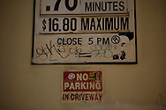 Graffiti covers parking and no parking signs in Los Angeles.
