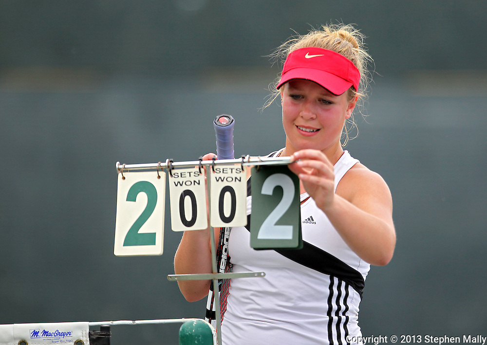 Iowa City High's Eve Small flips the score cards during the Singles Draw finals match of the Class 2A state tennis tournament at Veterans Memorial Tennis Center in Cedar Rapids on Friday, May 31, 2013.