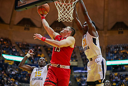 Jan 2, 2019; Morgantown, WV, USA; Texas Tech Red Raiders guard Matt Mooney (13) shoots in the lane during the first half against the West Virginia Mountaineers at WVU Coliseum. Mandatory Credit: Ben Queen-USA TODAY Sports