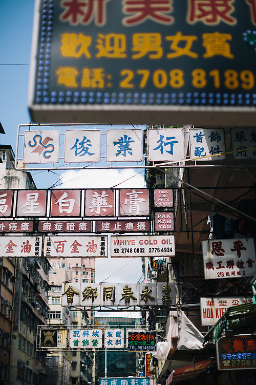 Signs and shophouses fill an alleyway in Mongkok, on the Kowloon side of Hong Kong.