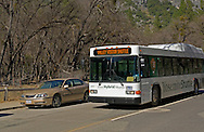 Hybrid fuel tourist bus on road in Yosemite Valley, Yosemite National Park, California