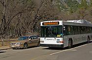 Hybrid fuel tourist bus on road in Yosemite Valley, Yosemite National Park, California