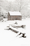 Slave cabin in winter at Sully Plantation.