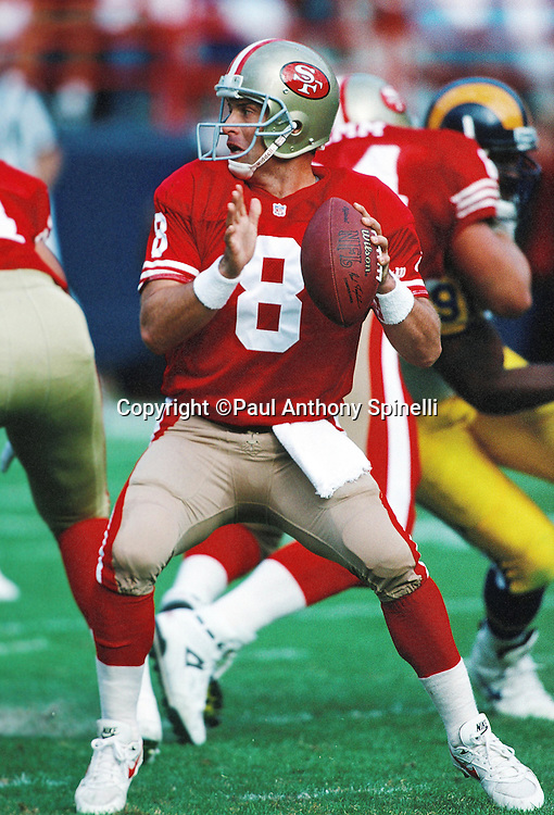San Francisco 49ers quarterback Steve Young (8) throws a pass during the NFL football game against the Los Angeles Rams on Nov. 28, 1993 in Anaheim, Calif. The 49ers won the game 35-10. (©Paul Anthony Spinelli)