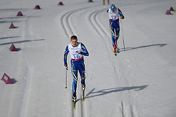REPTYUKH Ihor, SYTNYK Vitalii competing in the Nordic Skiing XC Long Distance at the 2014 Sochi Winter Paralympic Games, Russia