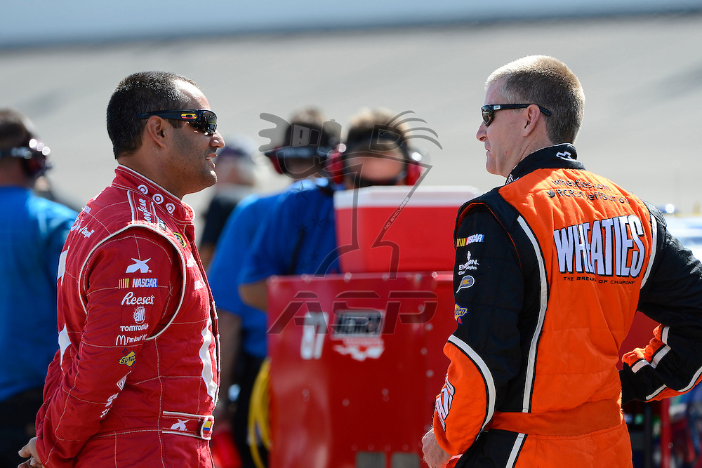 Brooklyn, MI  - Aug 17, 2012: Juan Pablo Montoya (42) and Jeff Burton (31) stands on pit row during qualifying for the Pure Michigan 400 at Michigan International Speedway in Brooklyn, MI.
