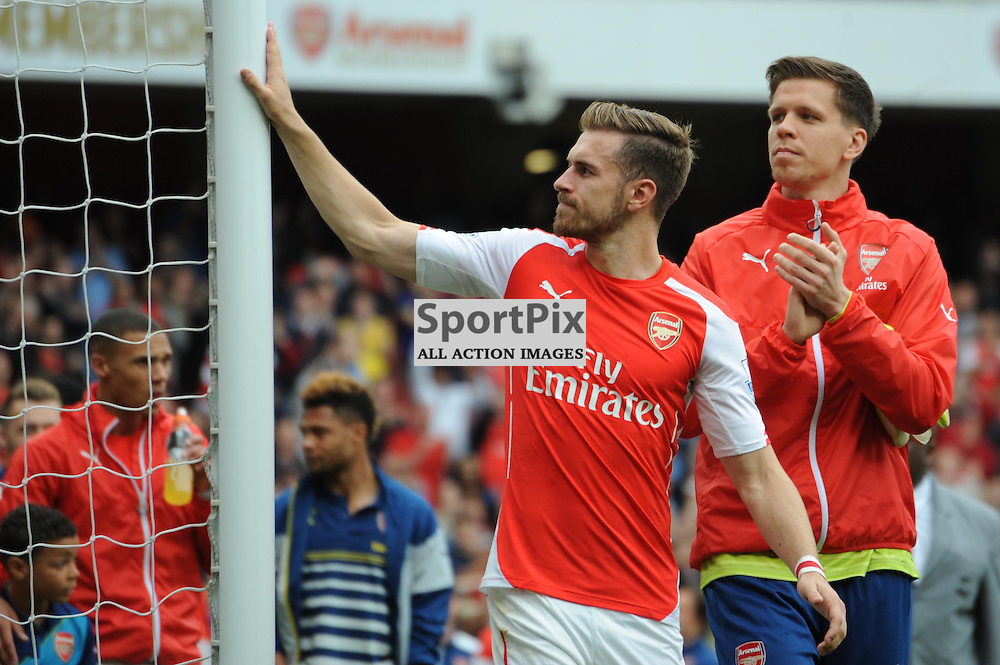 Arsenals Aaron Ramsey hits the bar that twice denined him during the lap of honour after Arsenal v West Brom match on Sunday 24th May 2015