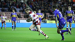 Wigan Warriors Dan Sarginson goes over for a try past Leeds Rhinos Tom Briscoe (right) during the Betfred Super League match against Wigan Warriors at the DW Stadium, Wigan.