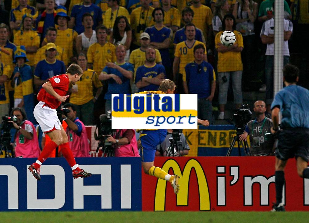 Photo: Glyn Thomas.<br />Sweden v England. FIFA World Cup 2006. 20/06/2006.<br /> Steven Gerrard (L) scores England's second goal.