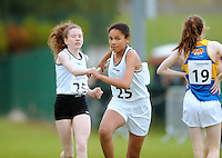 13 Aug 2016: Maud O'Shea, 13, left, from Kilcock, Kildare, passes the baton to Hanna Webb, 13, from Allen, Kildare, in the U14 Mixed Distance relay.  2016 Community Games National Festival 2016.  Athlone Institute of Technology, Athlone, Co. Westmeath. Picture: Caroline Quinn