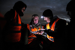 © Licensed to London News Pictures. 10/10/2013.  Corse Lawn, Gloucestershire, UK.  The Wounded Badger Patrol in Gloucestershire, where patrollers go out looking for dead or wounded badgers on public footpaths and roads.  The Government has licensed a pilot badger cull in parts of Somerset and Gloucestershire as part of efforts to reduce bovine tuberculosis in cows on farms and is considering extending the cull as the targets for culled badgers have not been met.  10 October 2013.<br /> Photo credit : Simon Chapman/LNP
