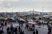 street scene with crowd and Galata bridge in the back Istanbul Turkey