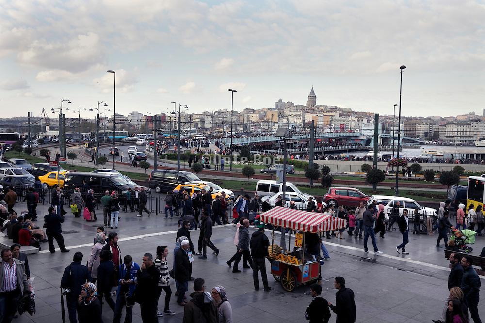 street scene with crowd and Galata bridge in the back Istanbul Turkey