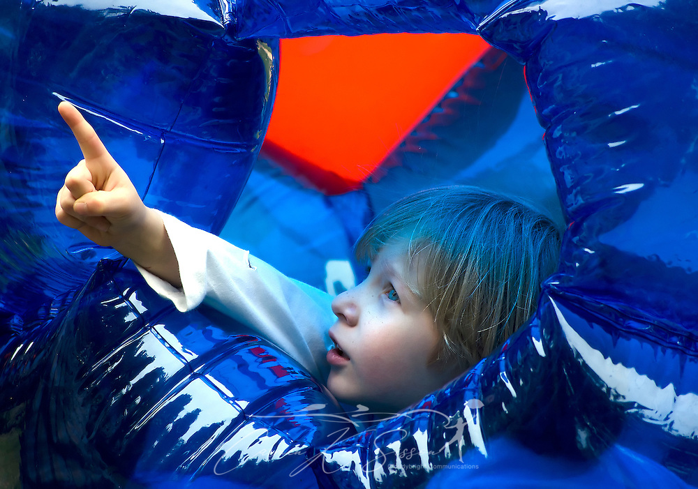 Elisha Perrigin, 6, points at a bird's nest he noticed while playing in a giant inflatable ball, April 21, 2012, at his father's home in New Hope, Miss. Elisha has been diagnosed with Asperger Syndrome, a form of autism.  (Photo by Carmen K. Sisson/Cloudybright)