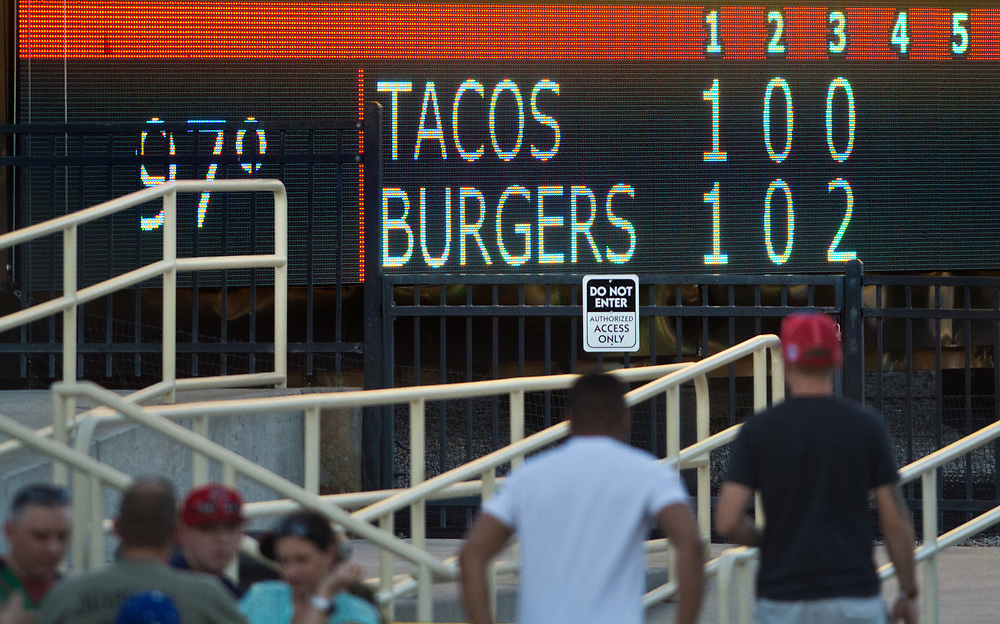 mkb061617d/sports//Marla Brose --  Albuquerque Green Chile Cheeseburgers played against the Fresno Tacos, June 16, 2017, at Isotopes Park in Albuquerque, N.M. The  Albuquerque Green Chile Cheeseburgers took the field for one night only.  (Marla Brose/Albuquerque Journal)