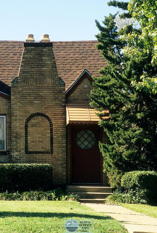 Craftsman style 1940s brick house with decorative chimney