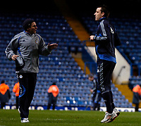 Photo: Ed Godden.<br />Chelsea v Fulham. The Barclays Premiership. 30/12/2006.<br />Injured Chelsea player John Terry trains on the pitch after the match.