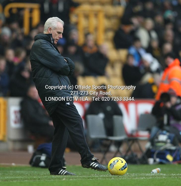 12/02/2012 Wolverhampton Wanderers v West Bromwich Albion.<br /> Mick McCarthy kicks the ball back into play.<br /> Photo: Mark Leech.