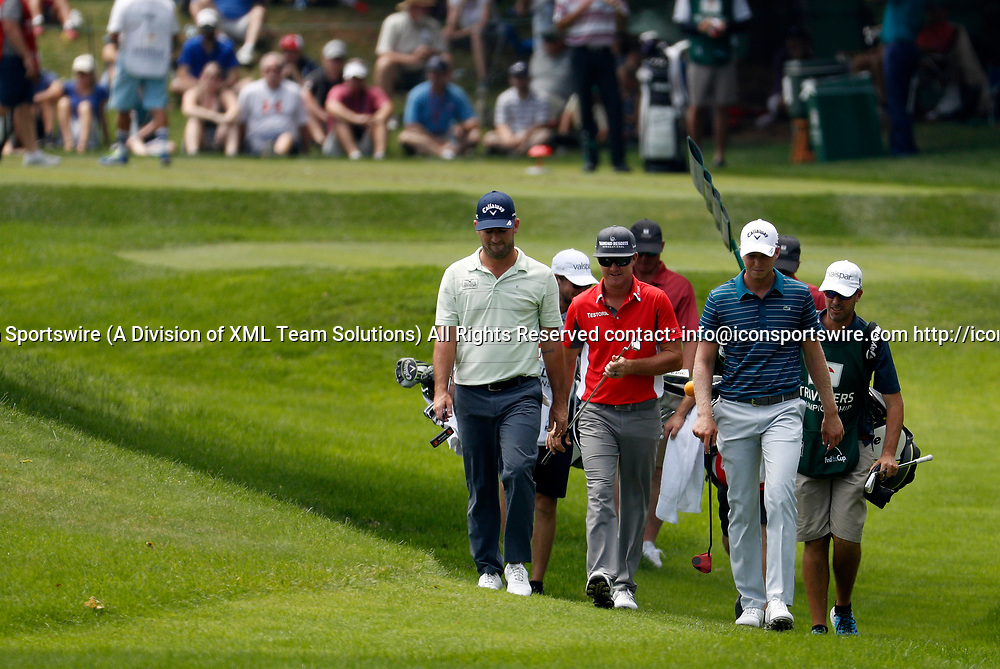 CROMWELL, CT - JUNE 23: Matt Every, Brian Gay and Daniel Berger walk to the 8th green during the second round of the Travelers Championship on June 23, 2017, at TPC River Highlands in Cromwell, Connecticut. (Photo by Fred Kfoury III/Icon Sportswire)