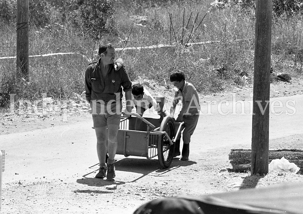 Pte Tom Dennieffe, Kilkenny giving some local boys a ride in a box car near Camp at Haris, South Lebanon, 15/06/1978 (Part of the Independent Newspapers Ireland/NLI Collection).
