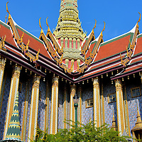 The Royal Pantheon at Grand Palace in Bangkok, Thailand<br /> In 1782, King Buddha Yodfa Chulaloke, better known as Rama I, founded the Chakri Dynasty in Bangkok.  His direct descendant Rama IX has been the King of Thailand since 1946.  A life-size statue of the prior eight monarchs is inside the Royal Pantheon.  Also called the Prasat Phra Thep Bidorn, this building with a corn-cob shaped tower (called a prang) is on the east end of Upper Terrace at the Temple of the Emerald Buddha.  It is only open to the public on Chakri Day which is celebrated on April 6.