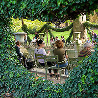 People enjoying the Luxembourg Gardens at the Medici Fountain.