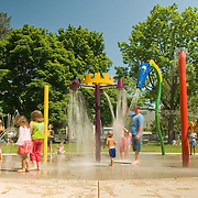 Kids playing at the neighborhood water park.