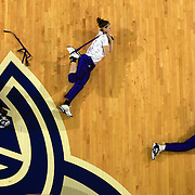 Members of the Drake University women's basketball team go through a pre-game stretching routine before one of their games in 2008.  Members of the Missouri Valley Conference, the team plays their home game in the Knapp Center on the Drake campus in Des Moines, Iowa.