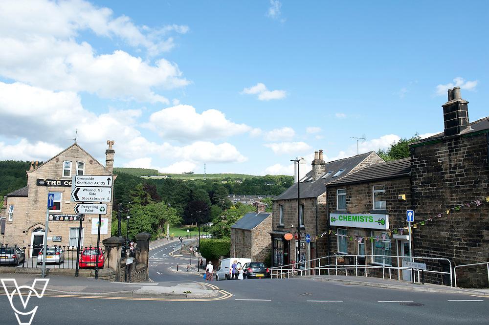 Pictured is Oughtibridge Post Office amongst the other local shops<br /> <br /> Oughtibridge Post Office, Sheffield.<br /> Date: July 14, 2015