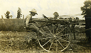 Farm worker ploughing while arming in the midwest during the 1920s or 1930s.