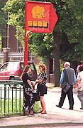 Friends age 25 talking on street corner.  Gdansk Poland