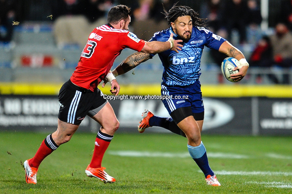 Ma'a Nonu of the Blues is tackled by Ryan Crotty of the Crusaders in the Super rugby match,  Crusaders v The Blues, at AMI Stadium, Christchurch, on the 5 July 2014 . Photo:John Davidson/www.photosport.co.nz